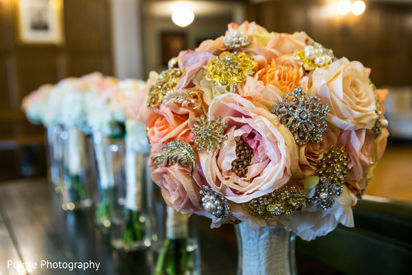 Lovely flower arrangements for Indian wedding in Detroit, Michigan Fusion Wedding by Pointe Photography