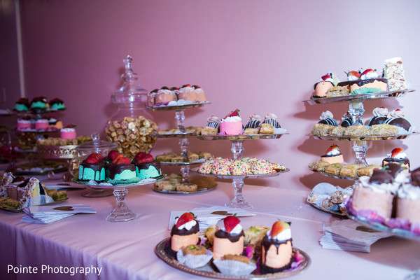 Stunning cake & treats setting for Indian wedding reception in Detroit, Michigan Fusion Wedding by Pointe Photography