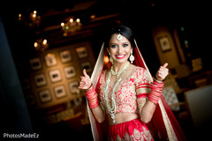 Vibrant indian bride in her red bridal attire.