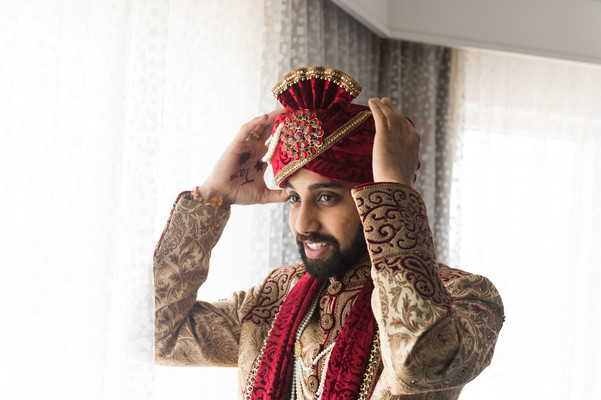 red and golden sherwani,red turban,groom fashion