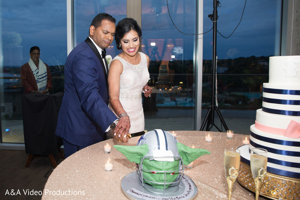 Bride and Groom Cutting Cake in Austin, TX Fusion Indian Wedding by A&A Video Productions