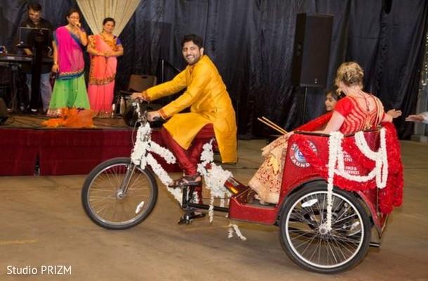 Couple enters on a rickshaw