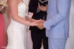 christian ceremony,christian wedding ceremony,fusion wedding ceremony,ring exchange,altar,ring exchange at the altar,wedding vows,wedding vows at the altar