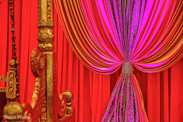 Pink and red draped  garba stage.