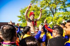 Indian groom carried by groomsmen.