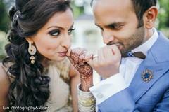 Elegant bride and groom showing their wedding rings.