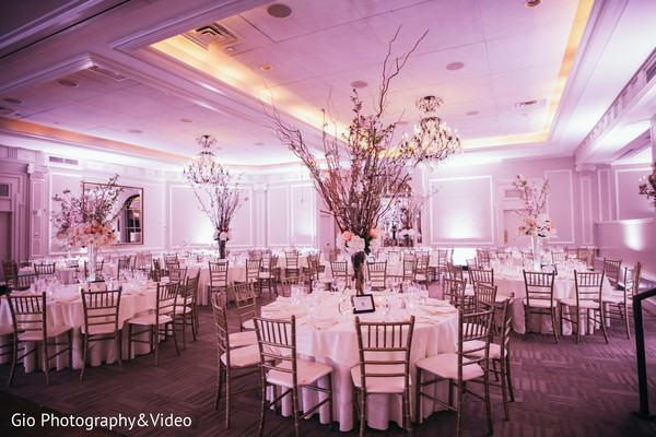 Gorgeous white themed indian reception decoration.