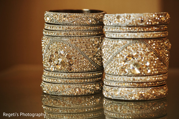 Glamorous indian bride golden bangles. in Herndon, VA Indian Wedding by Regeti's Photography