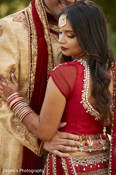 Cute photo of indian bride  and groom. in Herndon, VA Indian Wedding by Regeti's Photography