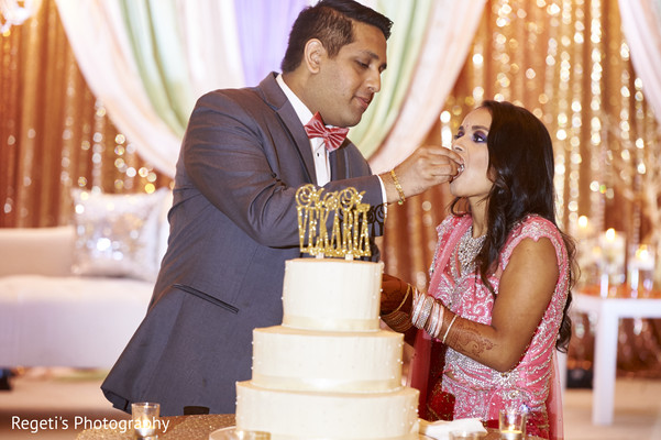 Indian wedding cake cutting. in Herndon, VA Indian Wedding by Regeti's Photography
