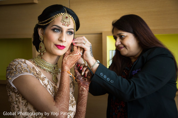 indian bridal fashions,indian bride getting ready,indian bridal make up