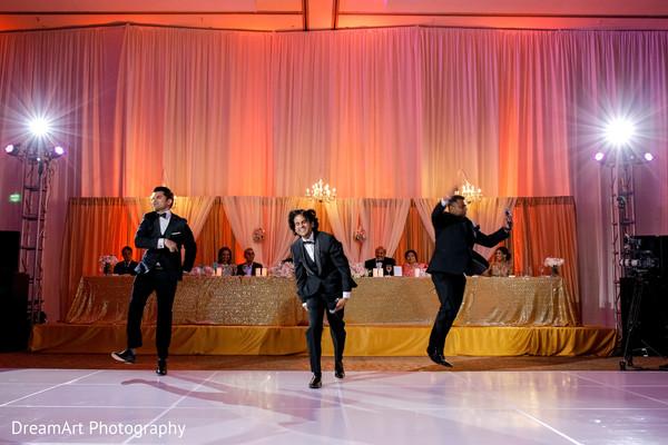 Great capture of groomsmen choreography.