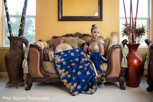 Indian Bride in Blue and Gold Wedding Lengha