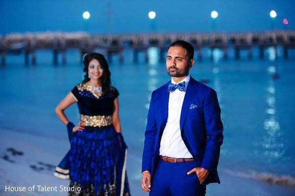 indian bride and groom,bride and groom reception celebration,indian bride and groom reception celebrations,indian bride,indian bride and groom beachside wedding portrait