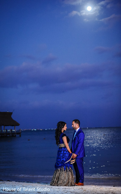 indian bride and groom,bride and groom reception celebration,indian bride and groom reception celebrations,indian bride,indian bride and groom beachside wedding portrait
