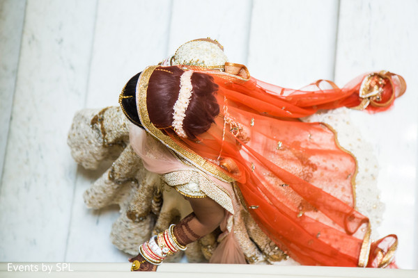 White wedding lengha with red veil