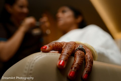 Indian bride's red nails and engagement ring.