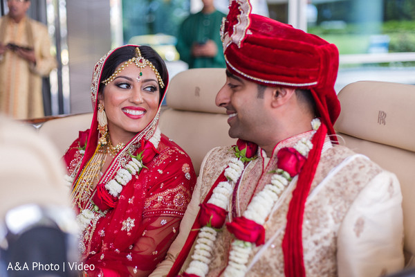 Lovely indian couple exiting their wedding ceremony