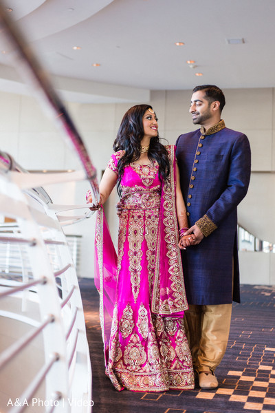 bring pink sari,blue and gold sherwani