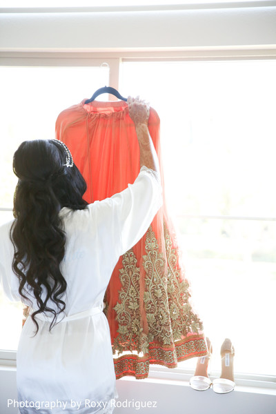 indian bride getting ready,indian bridal fashions,indian bride hair and makeup,mendhi artists