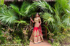 Dazzling indian bride in red and gold lengha.