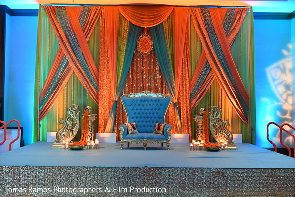 indian sangeet,indian wedding decorations,pre-wedding d?cor,pre-wedding decorations,orange and blue sangeet decor
