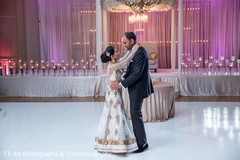 Indian bride and groom dancing portrait