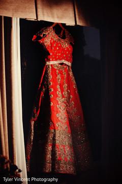 Traditional red wedding lengha.