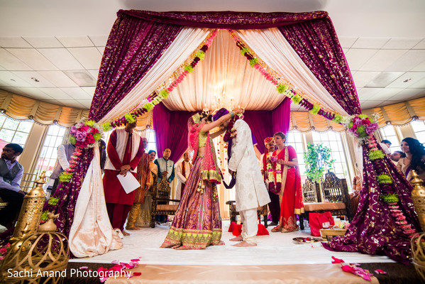 Sweet indian couple at their wedding ceremony. in Whippany, New Jersey Indian Wedding by Sachi Anand Photography