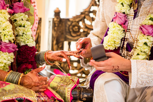 Ring exchange. in Whippany, New Jersey Indian Wedding by Sachi Anand Photography