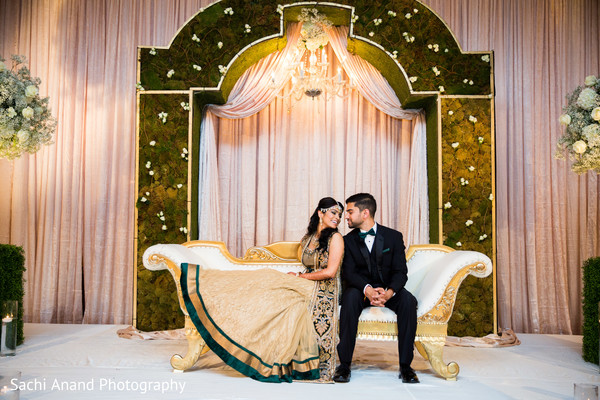 See this dreamy indian wedding reception stage. in Whippany, New Jersey Indian Wedding by Sachi Anand Photography