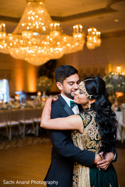 Indian lovebirds having their first dance. in Whippany, New Jersey Indian Wedding by Sachi Anand Photography