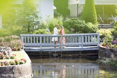 Indian couple kissing on a bridge.