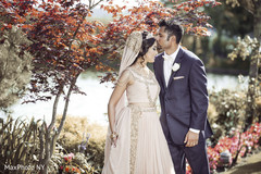Indian groom gives a sweet kiss to his bride.