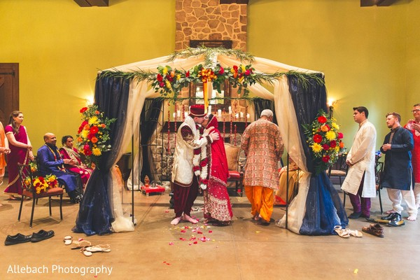 Lovely indian couple kissing during wedding ceremony