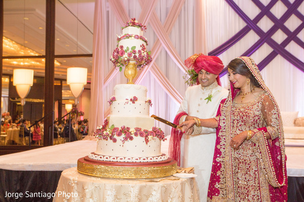 """cake cutting,cutting the cake,indian wedding photography,indian bride and groom reception,indian reception pictures,indian bride and groom reception photography,indian wedding reception photos,indian wedding reception,indian wedding reception pictures,indian wedding cakes"