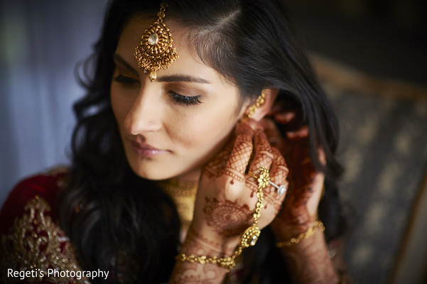 indian bride getting ready,bridal earrings