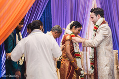 Groom exchanging jaimala