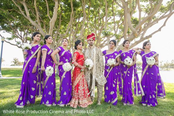 Purple and gold saris
