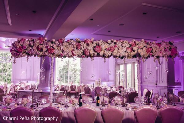 indian wedding reception,floral centerpieces