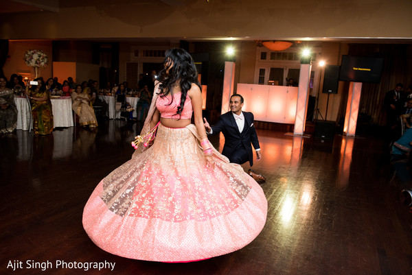Lovely indian couple enjoying their wedding reception.