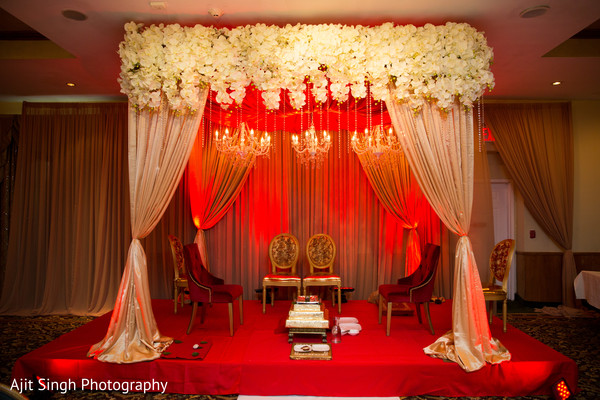 Gorgeous flower and draped mandap.