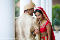 Indian bride and groom in traditional wedding attires.