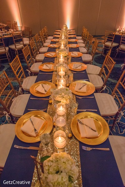 Gold and blue table setting in Greenville, SC, Fusion Wedding by Getz Creative Photography