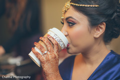 Lovely indian bride relaxing and getting ready.