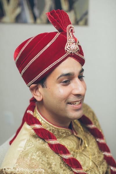 Raja wearing an elegant red turban.