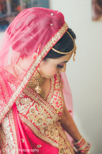 Red and gold embroidered wedding lengha.