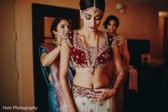 Charming maharani getting her bridal attire adjusted.