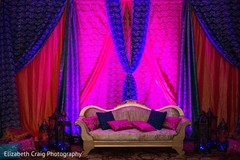 Hot pink and blue themed sangeet stage.