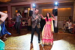 Indian couple showing off their moves at the sangeet celebration.